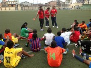 *Mercy Akide-Udoh speaking with the young girls at the trials.