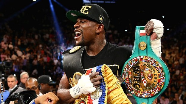 Mayweather yells after defeating Alvarez in Las Vegas.