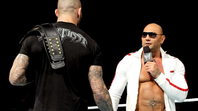 Batista tells Orton he's back for that belt
