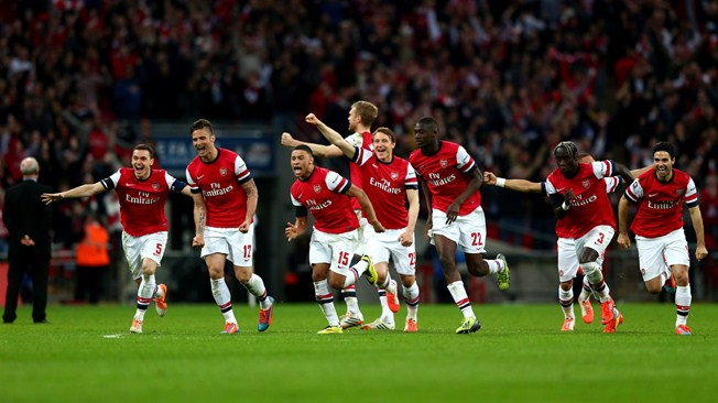 Arsenal celebrate beating Wigan