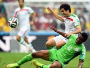 Mikel in ball chase with Iran player