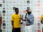Moses gets Gov's Cup trophy from Fashola