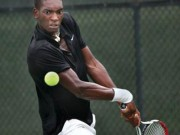 Takanyi of Zimbabwe returns a serve