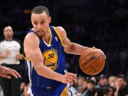 Curry of Golden State Warriors drives on