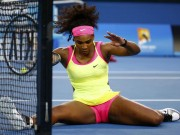 Williams of the U.S. reacts as she slips while chasing after a ball during her women's singles first round match against Van Uytvanck of Belgium at the Australian Open 2015 tennis tournament in Melbourne
