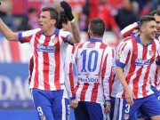 Atletico s Mandzukic celebrates a goal against Real Madrid