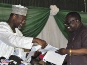 Jega receiving FCT Abuja results from Prof Faborode
