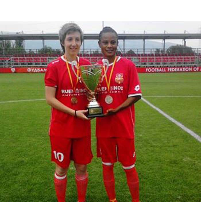 Glory with a teammate pose with the Marcedonian Cup
