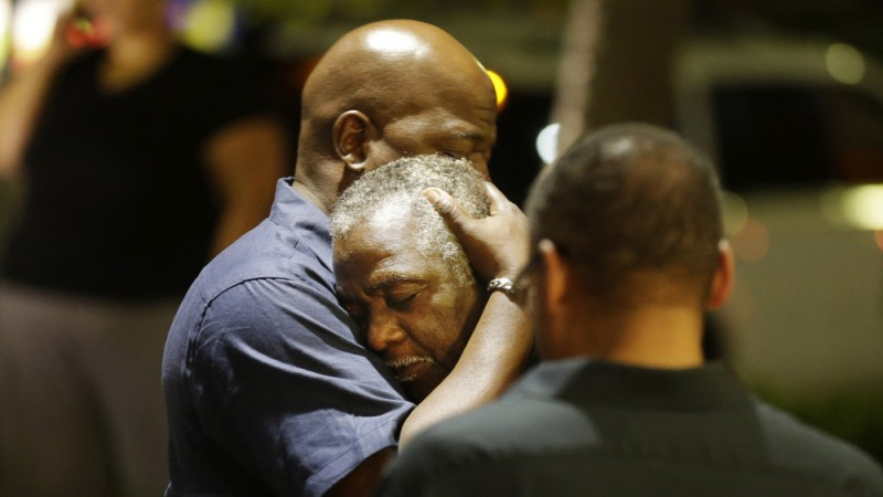 Church members console selves after shooting