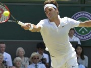 Federer returns a serve