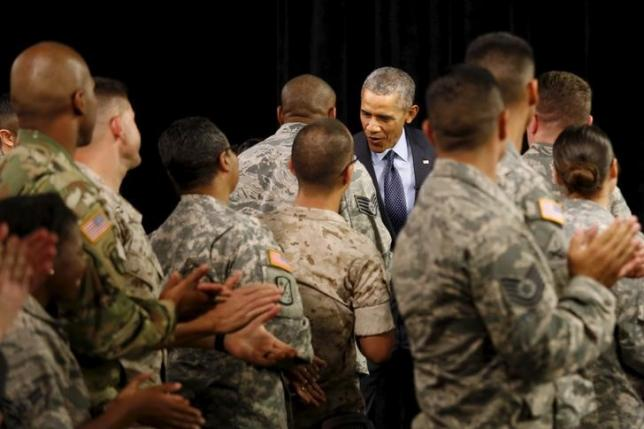 File photo of U.S. President Barack Obama shaking hands as he arrives in the studio for a TV appearance on Worldwide Troop Talk at Fort Meade in Maryland