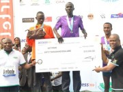 Gov Ambode presents winning cheque of Access Bank Lagos Marathon to Kiptom of Kenya
